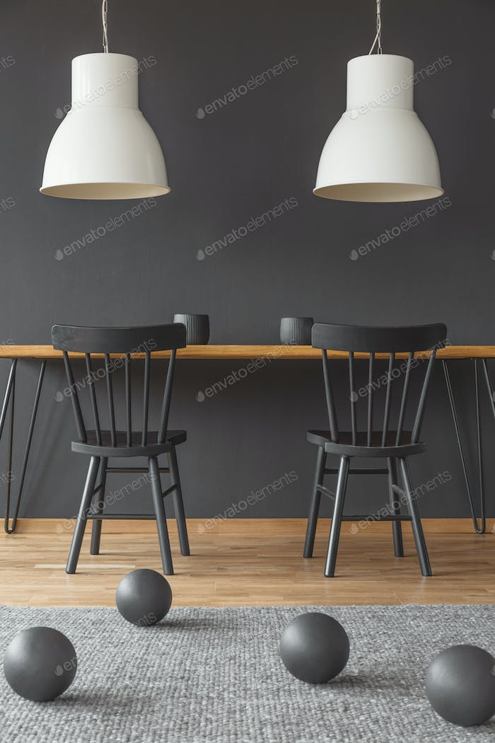 White lamps above dining table