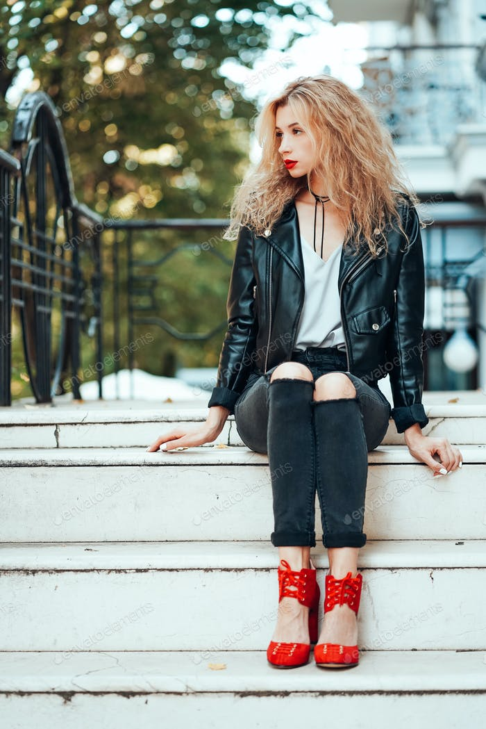 Young beautiful stylish girl posing