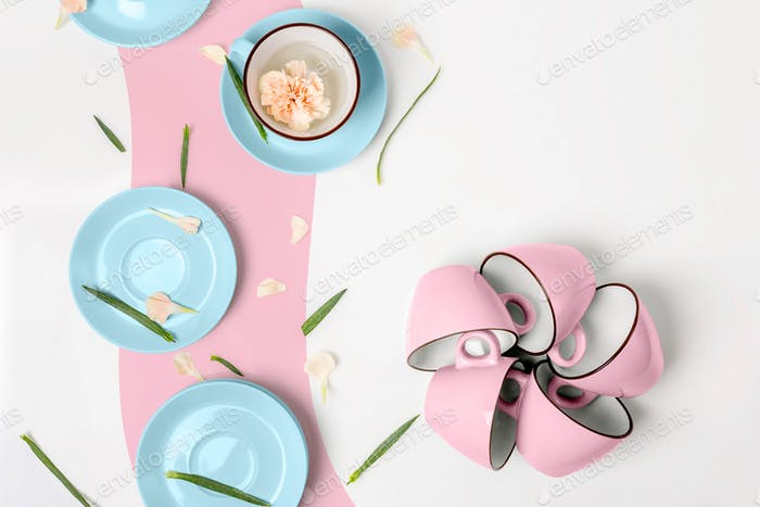 Blue and pink cups on white background