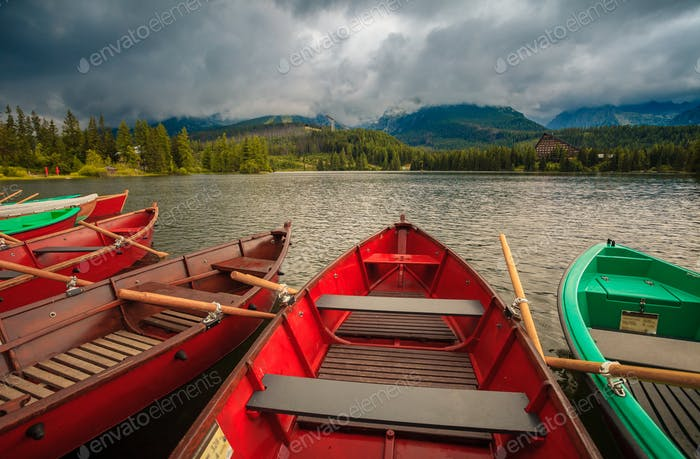 Colorful boats on the dock surrounded mountains