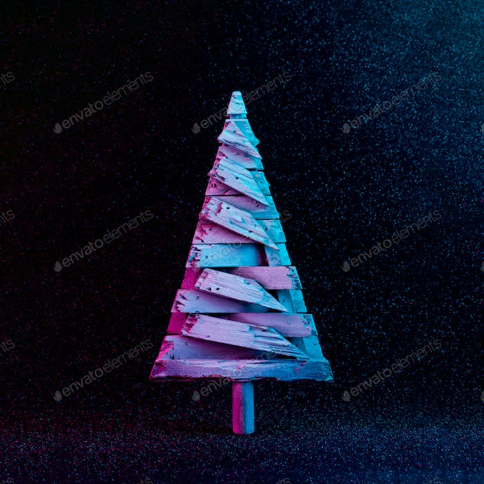 Christmas tree decoration in vivid neon colors. Christmas or winter dark background concept.