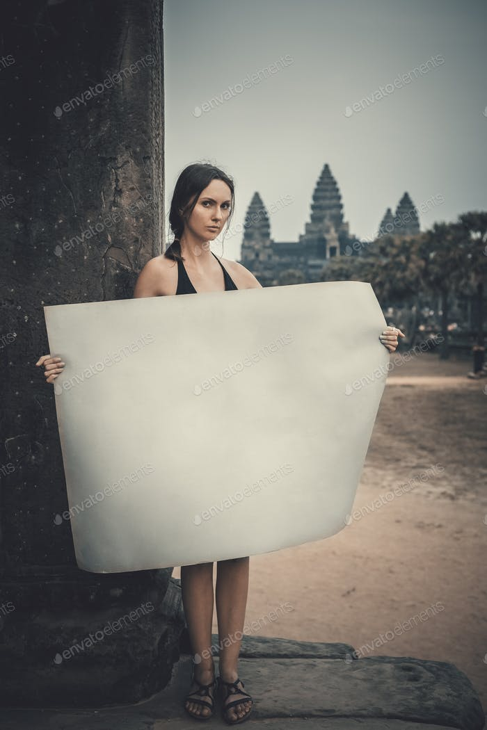 Young woman holding paper