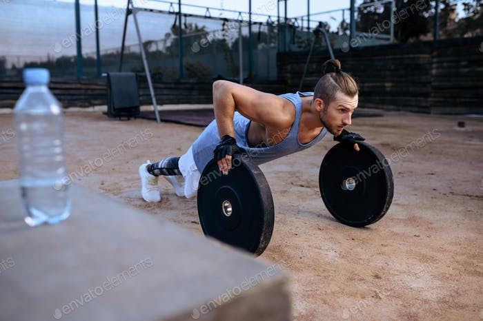 Man doing push-up exercise, street workout