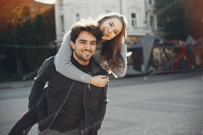 Beautiful couple spend time in a summer city
