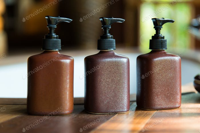 bottles with liquid soap or lotion at bathroom