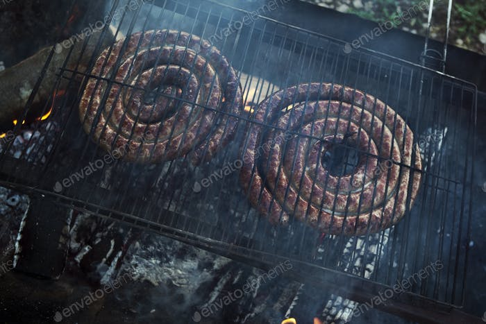 Baking sausage on a grill