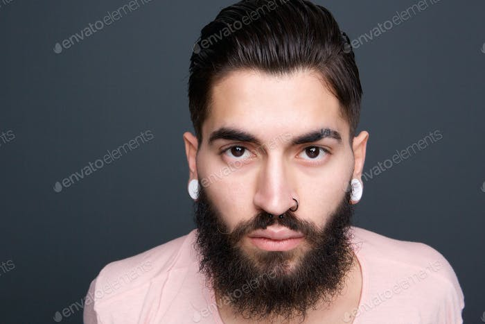 Young guy with beard and piercing