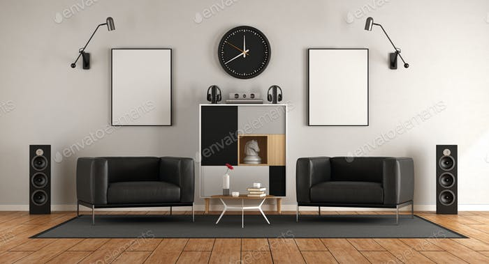 living room with two black armchairs and audio equipment