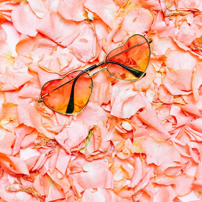 Minimal creative design. Glamorous sunglasses on flowers backgro
