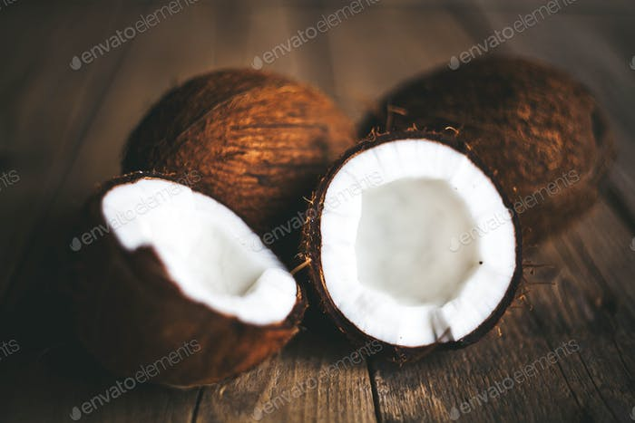 Thumbnail for Ripe half cut coconut on a wooden background. Ripe half cut coconut on a wooden background