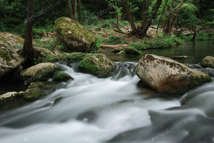 Silky river flow near waterfall known as Santa Margarida