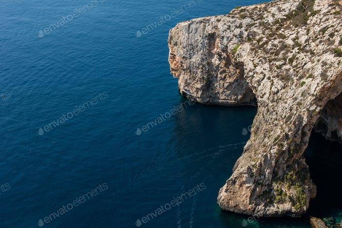 Blue grotto cave in Malta. Natural limestone arch over a lagoon