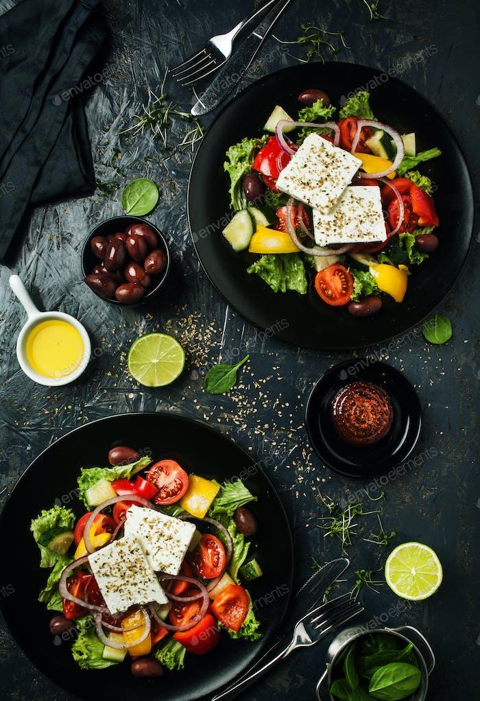 Fresh tasty greek salad on plates