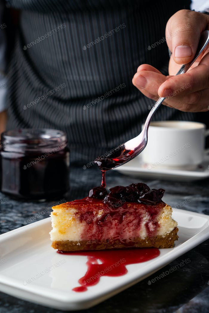 chef makes the final touch on cheesecake