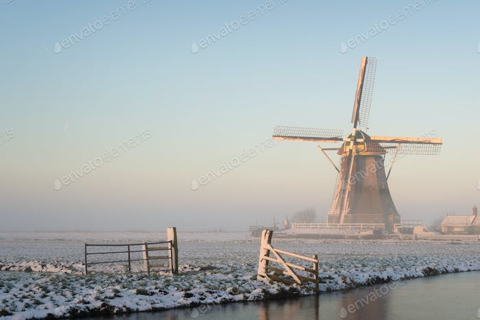 Windmill in a winter landscape