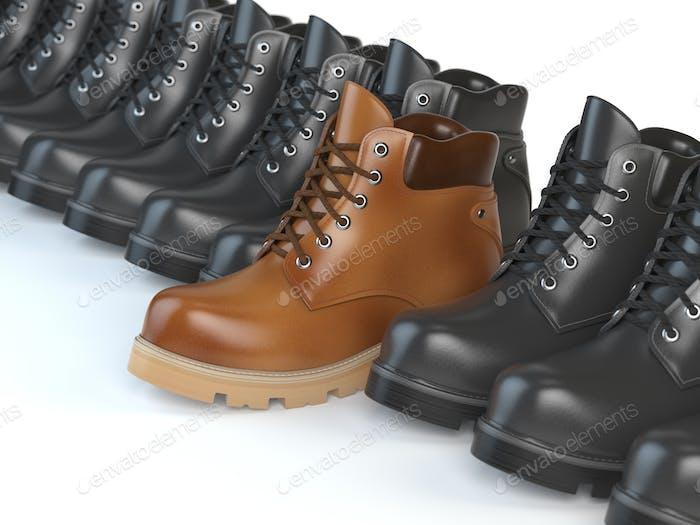 One unique brown boot in the row of black boots. Marketing conce