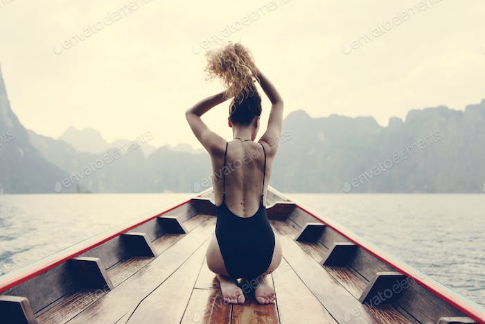 Beautiful woman posing on a boat