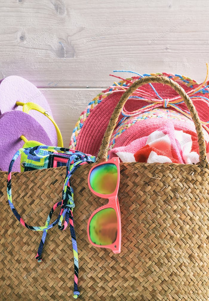 Beach accessories in a bag. Summer holiday concept