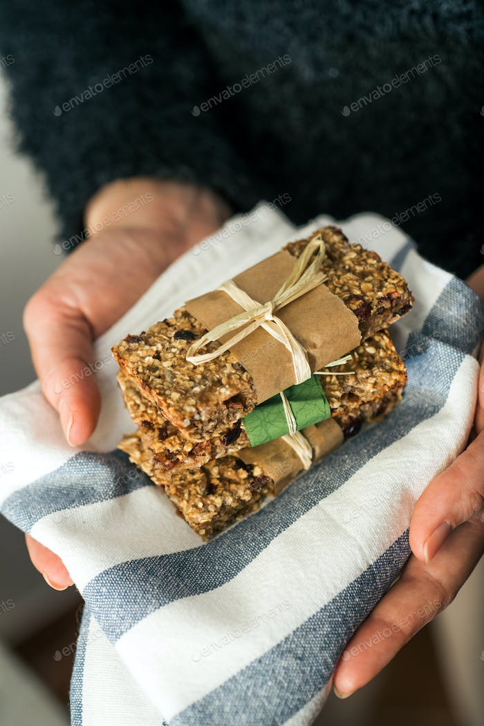 Holding delicious homemeade granola bars