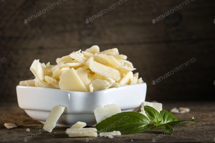 parmesan cheese flakes and basil