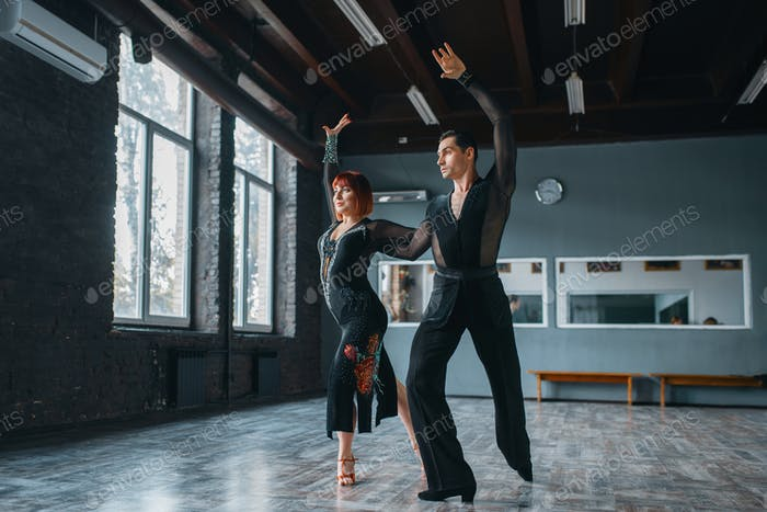 Elegance man and woman on ballrom dance training