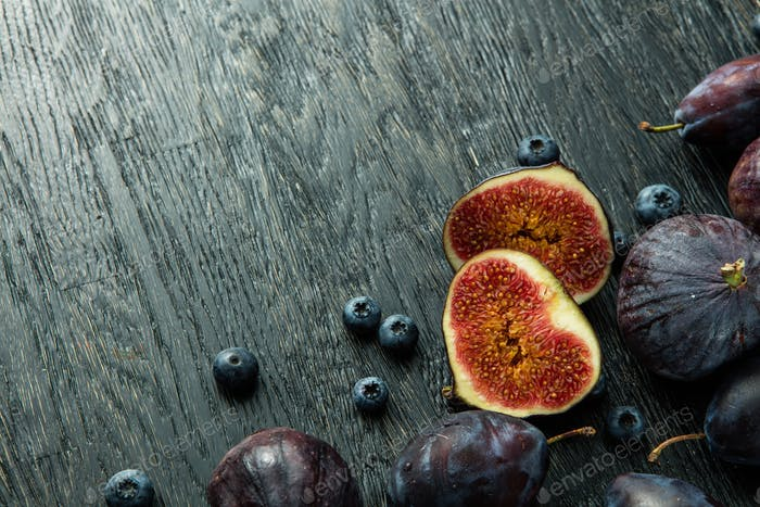 sliced figs and ripe berries