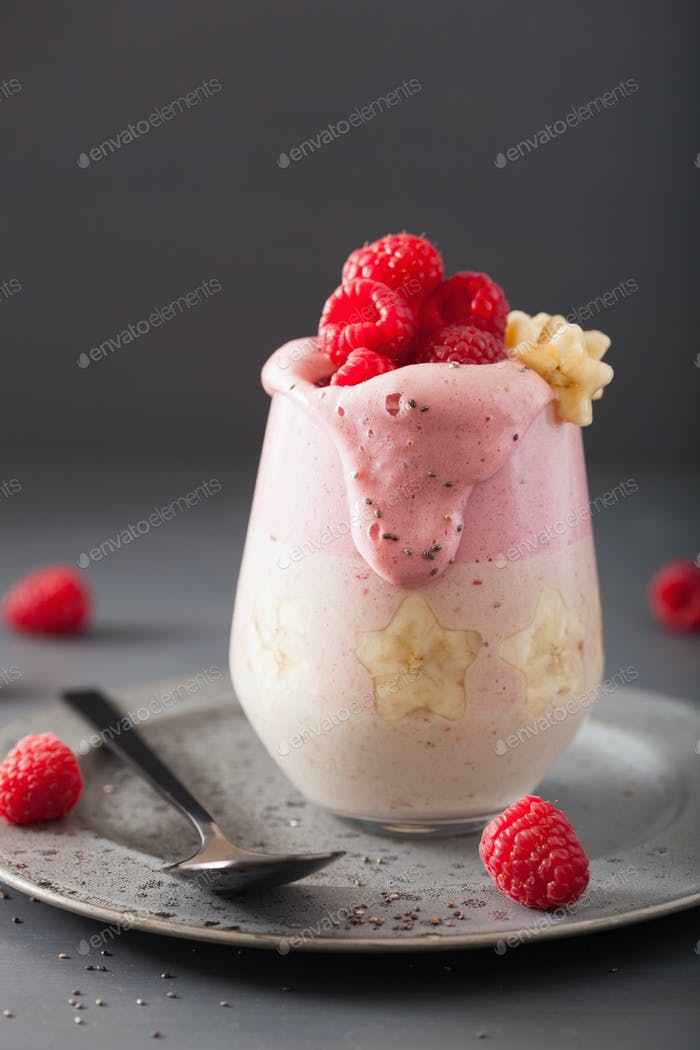 healthy layered raspberry banana smoothie in glass