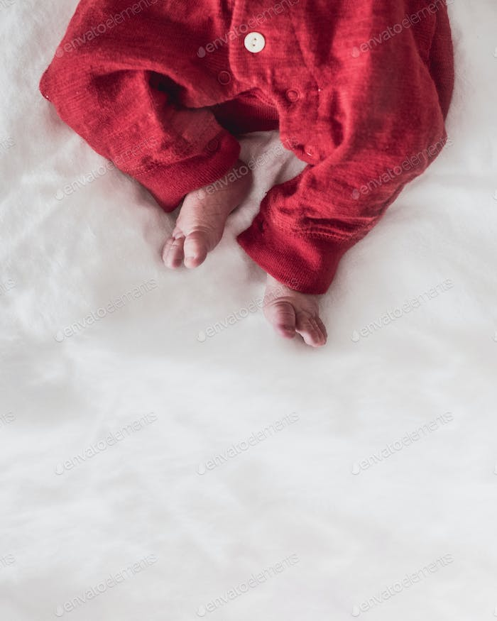 Newborn Baby in a Red Outfit