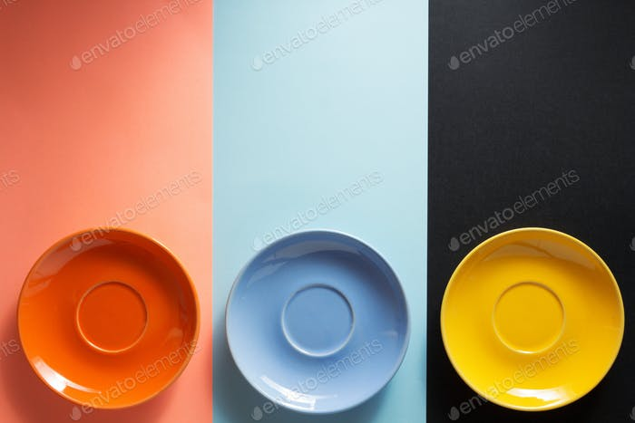 empty saucer at colorful background