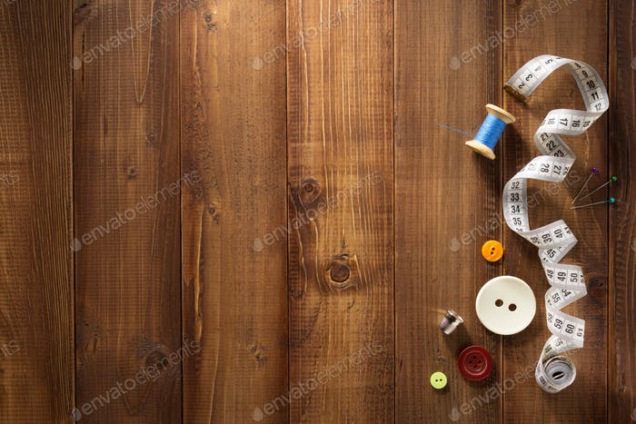 sewing tools and accessories on wood