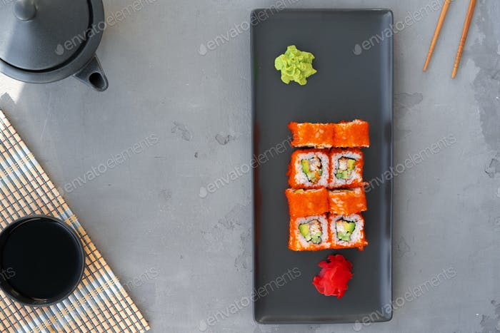 California sushi roll served on gray background