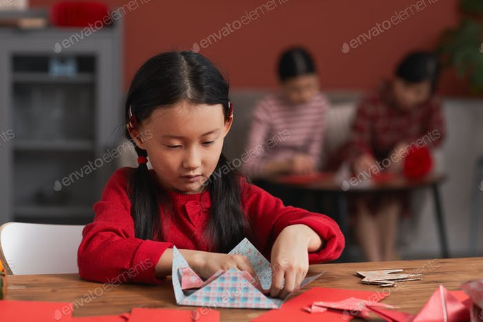 Creative Chinese Girl Using Colored Paper