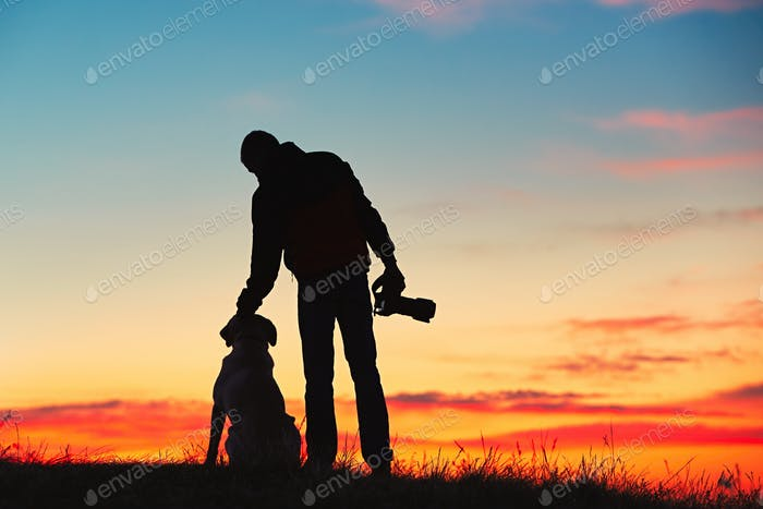 Photographer with dog