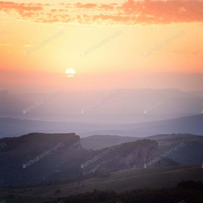 Sunrise over the mountains and the forest at dawn