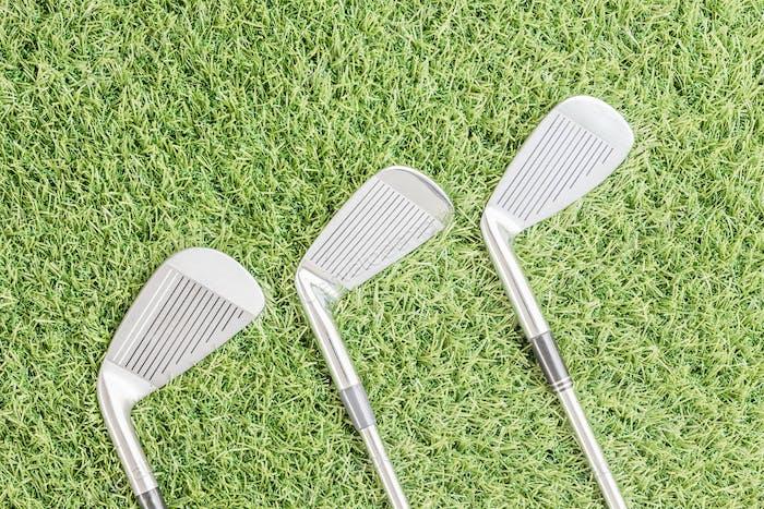 Row of golf club on grass_-4