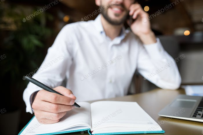 Unrecognizable Businessman Writing Notes