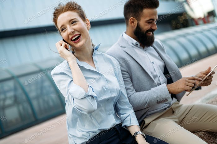 Thumbnail for Smiling business man and woman chatting outdoor