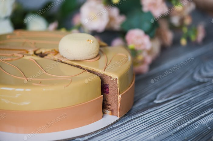 Bakery with piece of unusual yellow mousse cake with almond dacquoise, raspberry confit, crispy