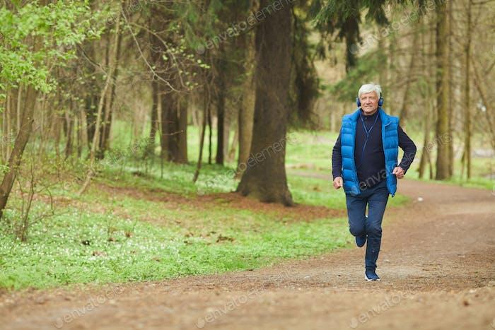 Active Senior Man Running in Forest