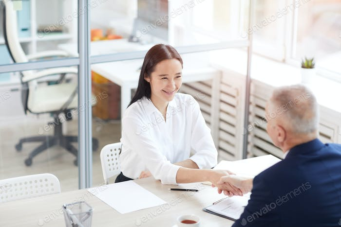 Intern Shaking Hands With Manager