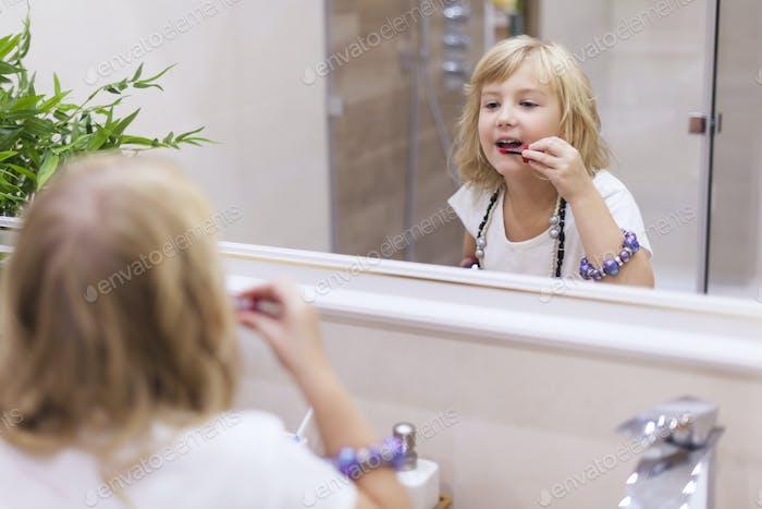 Using some of mum's lipstick