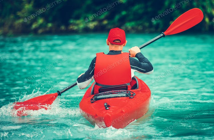 Kayaker on the Scenic Lake Trip