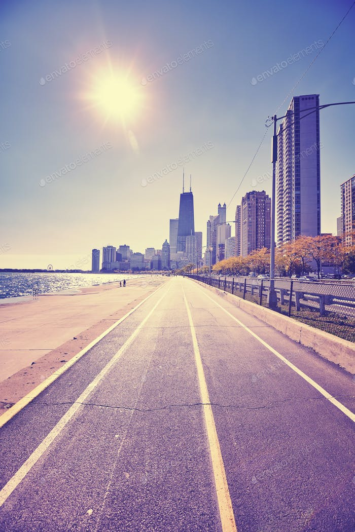 Retro stylized Chicago waterfront against sun with lens flare