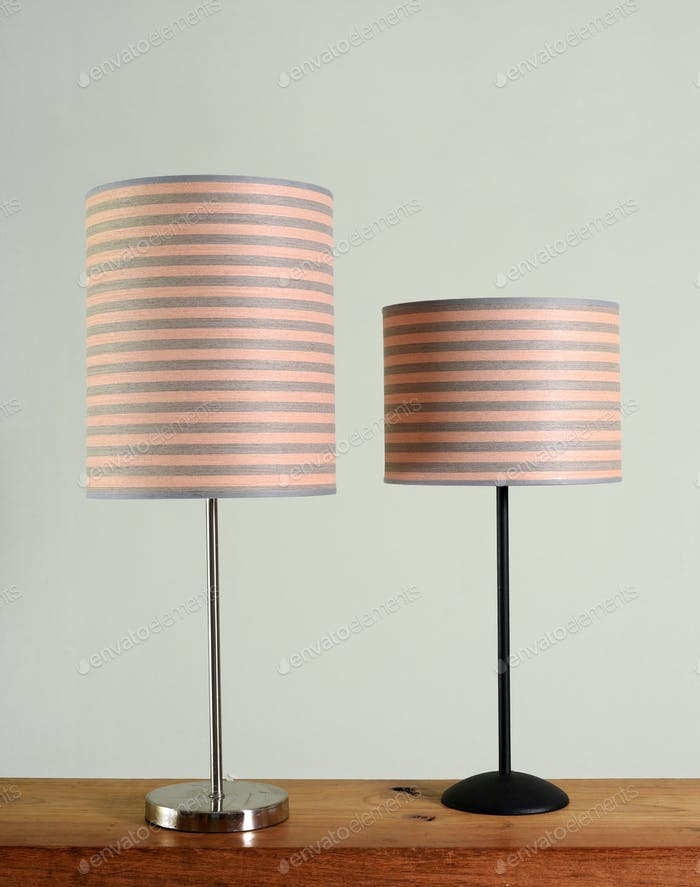 Two metal lamps with striped shades