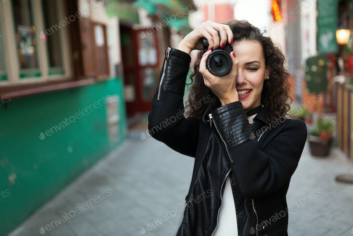 Woman traveling and taking pictures