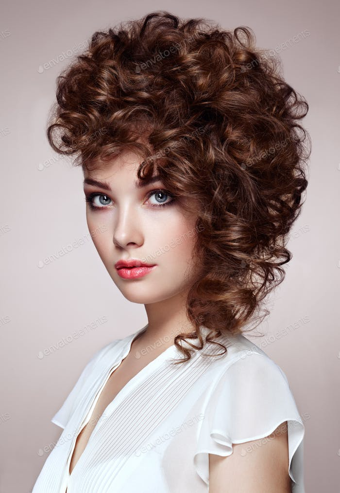 Brunette woman with curly and shiny hair