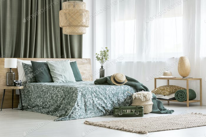 King-size bed with floral bedsheets