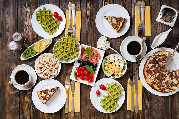Breakfast food table. Festive brunch set, meal variety with spin