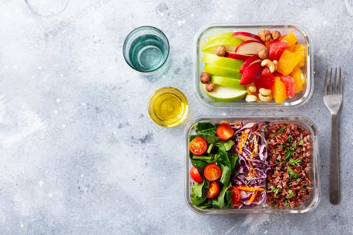 Lunch Box with Vegetables, Brown Rice and Fruits Salad. Healthy Eating. Copy space. Top view.
