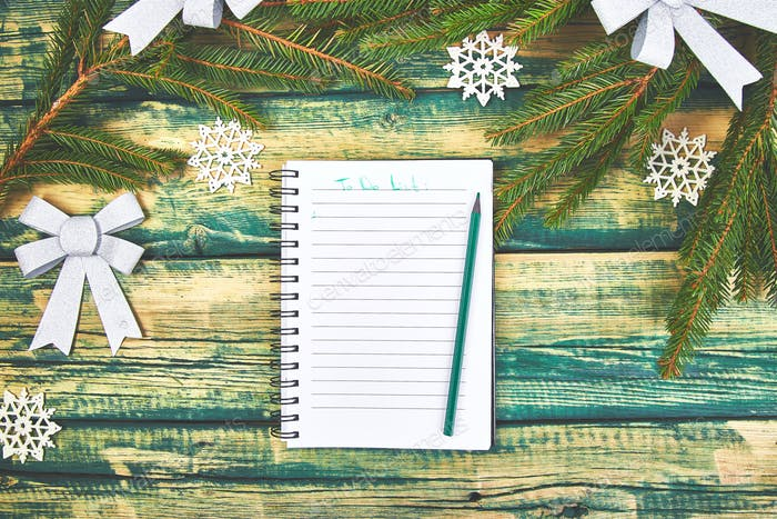 Christmas to do list on green rustic wooden background